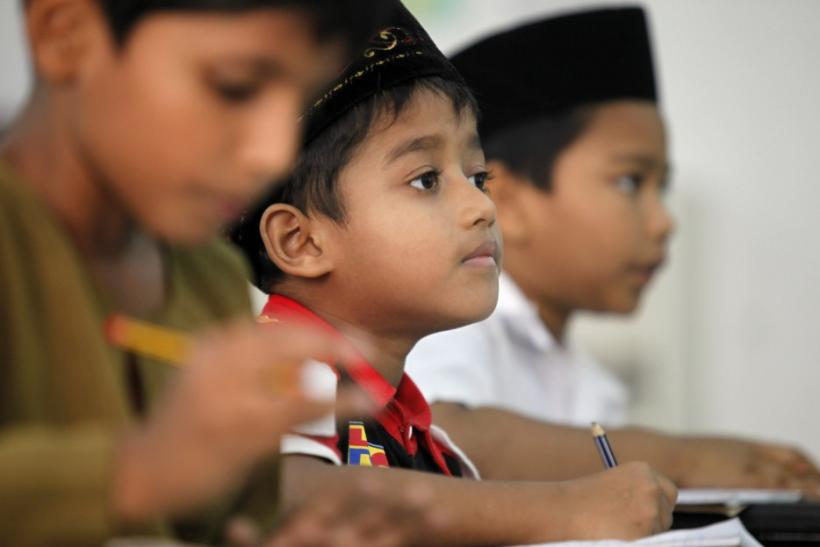 Young Myanmar refugees from the Rohingya ethnic minority attend their English class in Kuala Lumpur