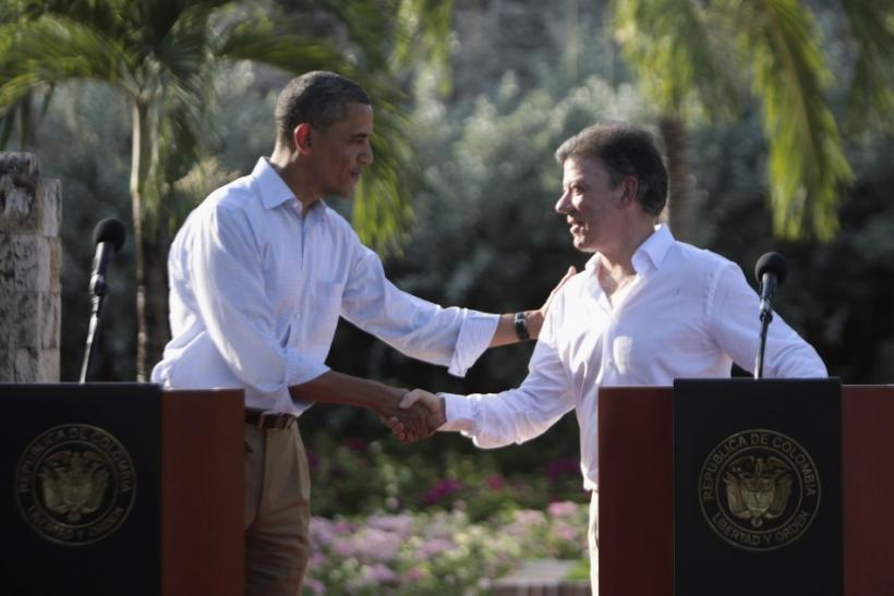 U.S. President Barack Obama and his Colombian counterpart Juan Manuel Santos shake hands at a joint news conference in Cartagena