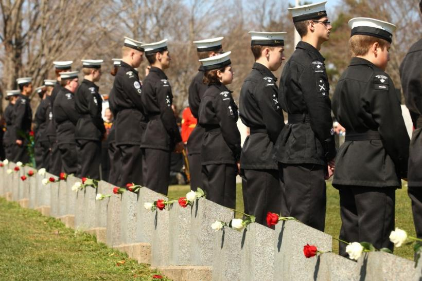 Canadian Sea Cadets stand next to grave of Titanic sinking victims in Halifax, Nova Scotia