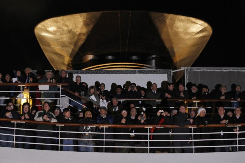 Passengers take part in service of remembrance aboard the Titanic Memorial Cruise in the western Atlantic Ocean