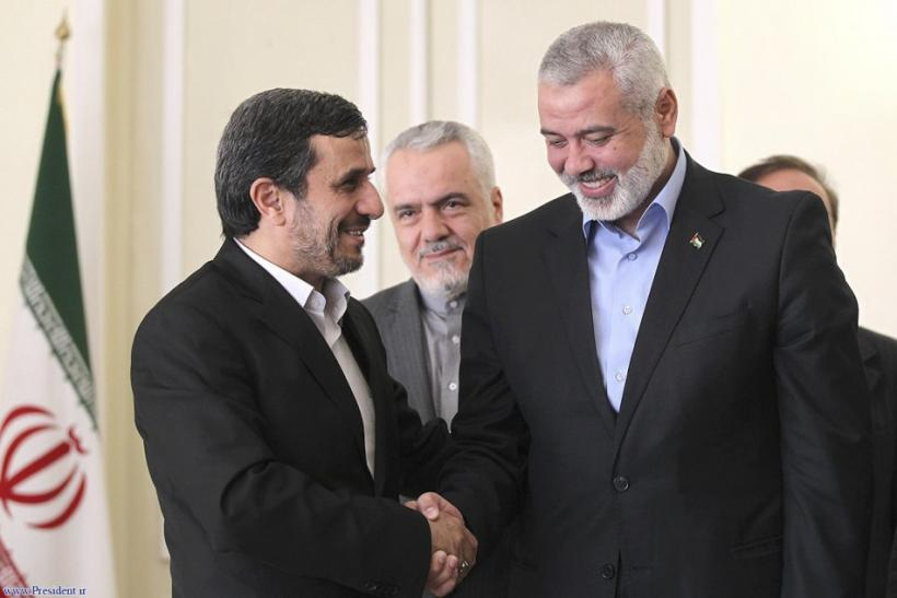 Iranian President Mahmoud Ahmadinejad welcomes Hamas leader Ismail Haniyeh at an official meeting in Tehran