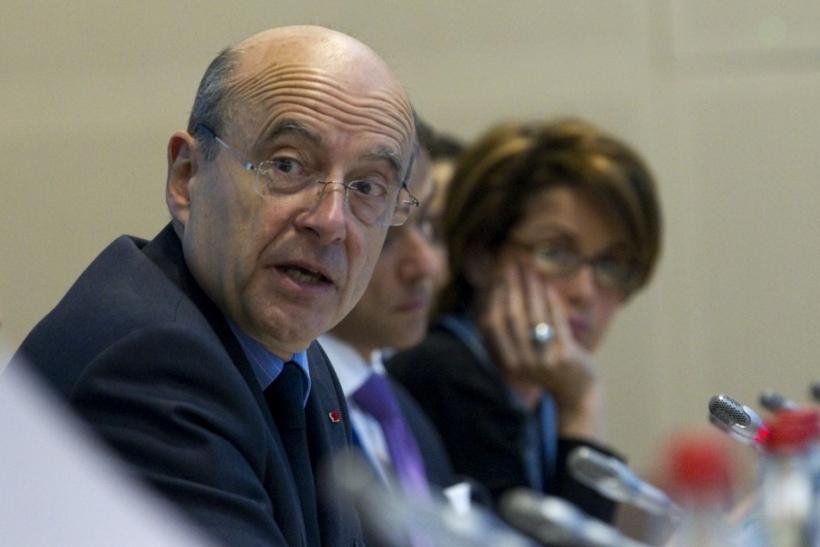 French Foreign Minister Juppe and Syrian Auditing Consultant Chatti as they attend an international conference on Syria in Paris