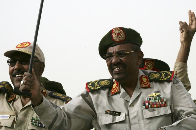 Sudanese President Omar al-Bashir and Defense Minister Muhammad Hussein during a Popular Defense Force rally in Khartoum in March