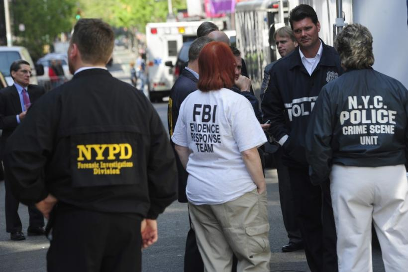 FBI and NYC police stand near apartment where they were searching basement for clues in 1979 disappearance of Etan Patz