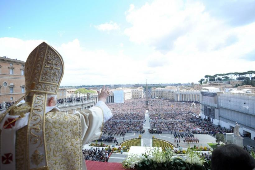 "Pope Benedict XVI waves as he makes his ""Urbi et Orbi"" (To the city and the world) address from a balcony in St. Peter's Square in Vatican"
