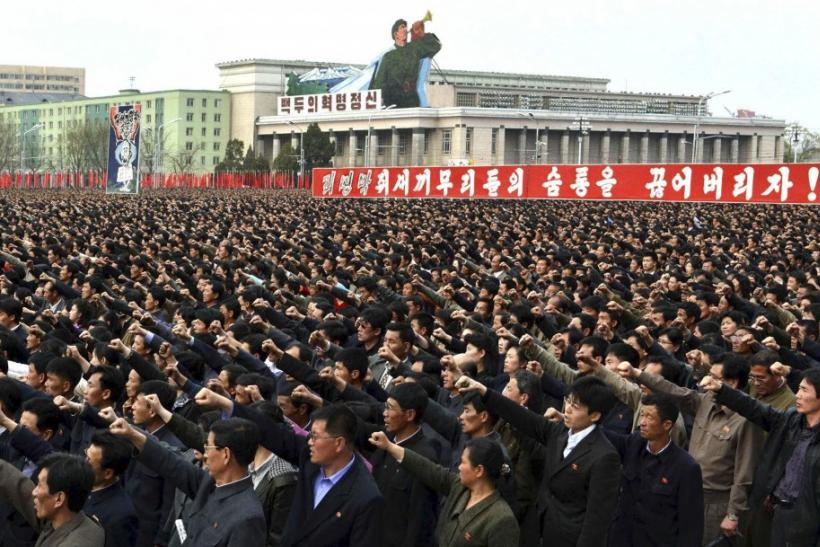 North Korean people and soldiers gather in Pyongyang to denounce South Korea's President Lee Myung-bak