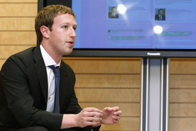 Facebook CEO Mark Zuckerberg speaks to Japanese Prime Minister Yoshihiko Noda in front of a monitor displaying a Facebook page of the Prime Minister's Office of Japan, as they meet at the latter's official residence in Tokyo on March 29, 2012.
