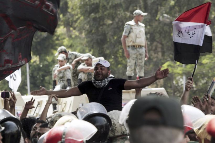 11 killed and 160 injured when unknown attackers storm anti-military protest in Cairo.