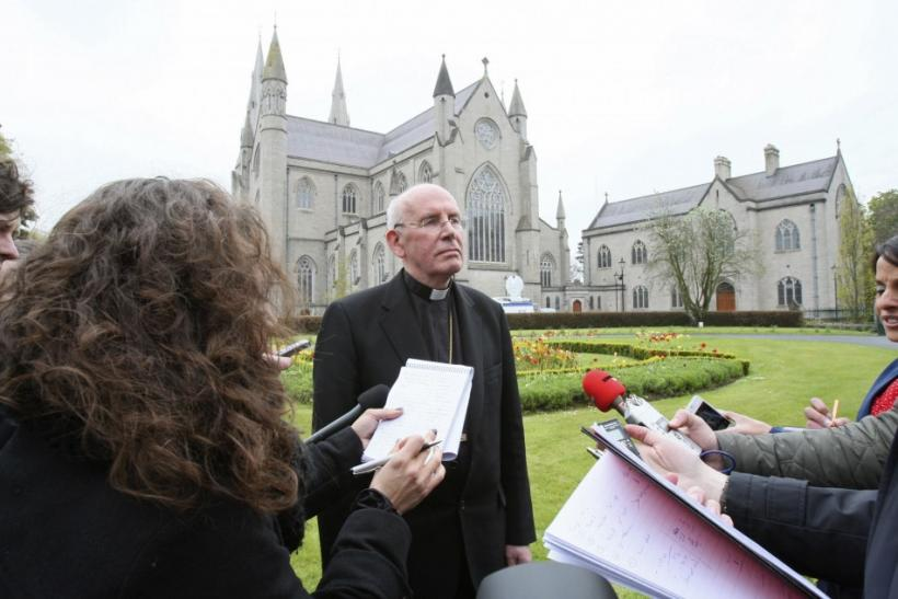 Cardinal Sean Brady speaks to members of the media outside Armagh cathedral in northern Ireland