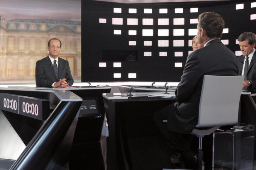 Francois Hollande, Socialist party candidate for the 2012 French presidential election, and Nicolas Sarkozy, France's President and UMP party candidate for his re-election are seen before their televised debate in La Plaine Saint-Denis