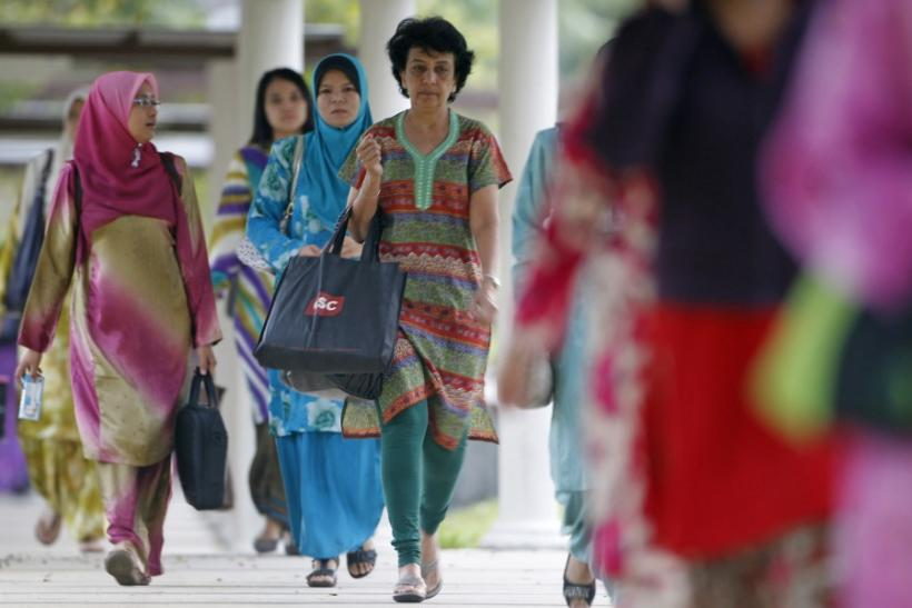 Workers arrive at their offices in Putrajaya