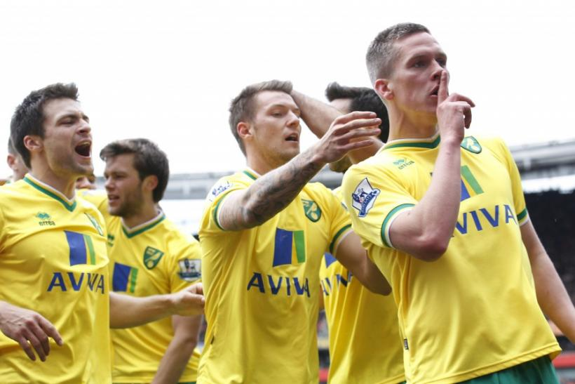 Norwich celebrates a goal by quieting Anfield.