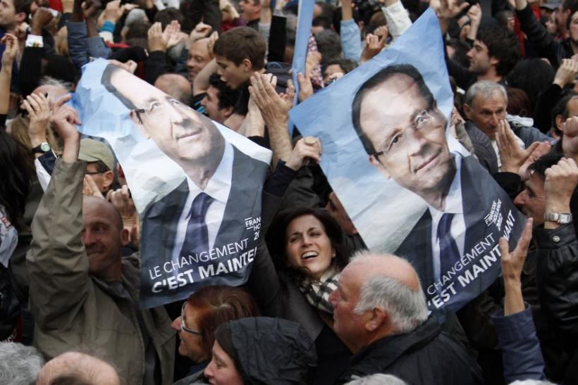 Supporters of Francois Hollande, Socialist party presidential candidate, react after results in the second round vote of the 2012 French presidential elections in Tulle