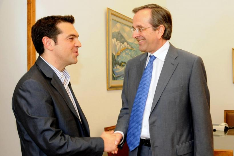 Greek conservative party leader Samaras shakes hands with Head of Greece's Left Coalition party Tsipras at the parliament in Athens