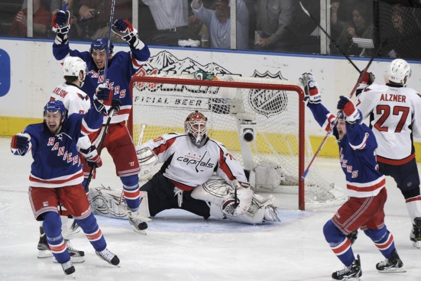 The Rangers celebrate after scoring the overtime winner in game five. The Rangers take on the Capitals at 7:30 p.m. ET.