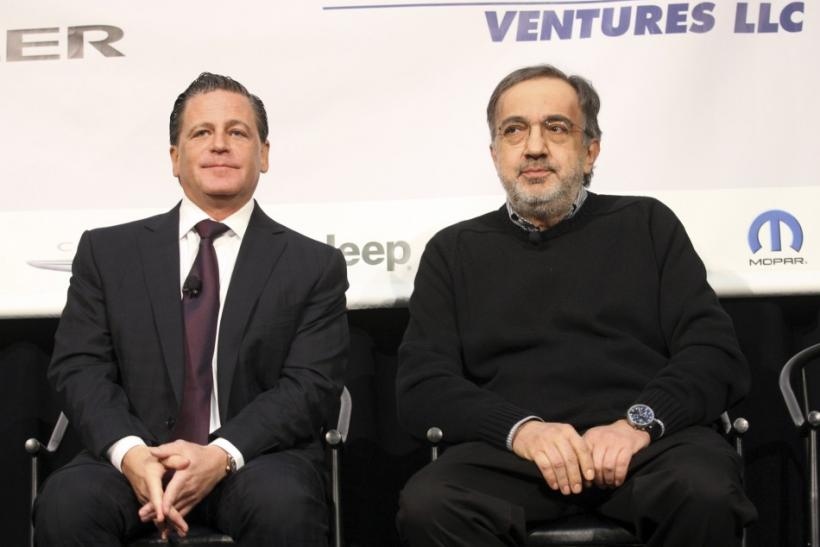 Sergio Marchionne (R), chairman and CEO of Chrysler Group LLC, sits next to Dan Gilbert, chairman of Rock Ventures and Quicken Loans, during an announcement that Chrysler Group will move some of its employees into the historic Dime Building, one of Gilber