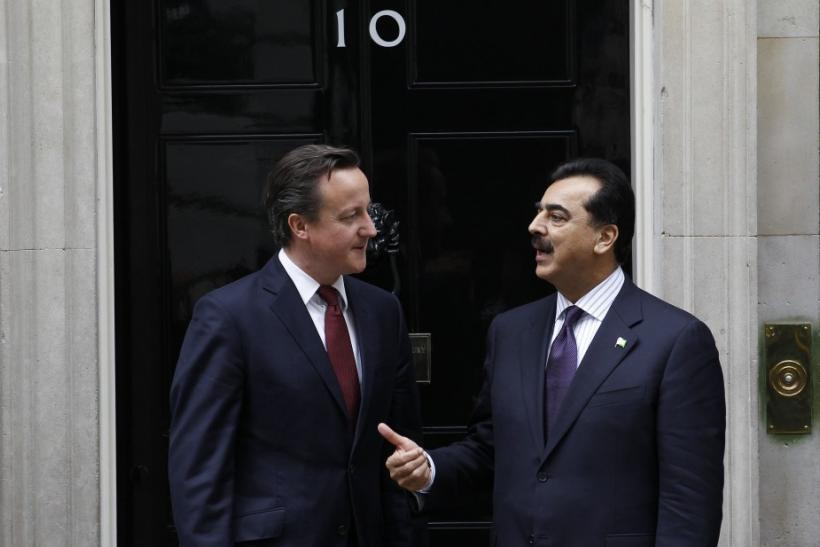 Britain's Prime Minister David Cameron poses for a photograph with Pakistan's Prime Minister Yusuf Raza Gilani outside 10 Downing Street in London