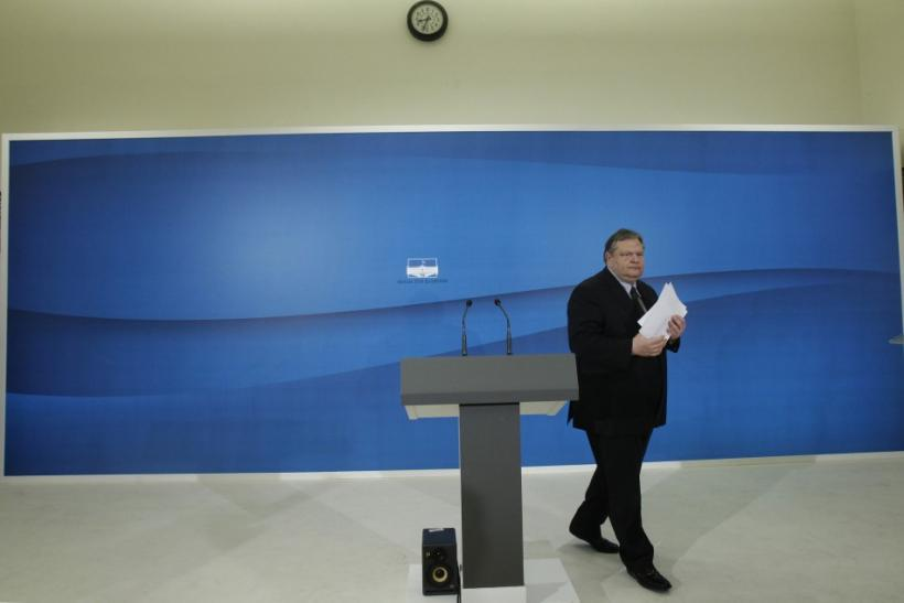 Socialist PASOK party leader Venizelos walks towards the exit after a news conference at the parliament in Athens