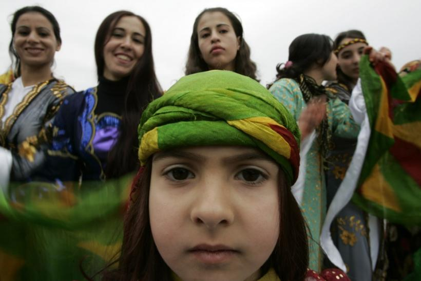 Kurds attend a gathering to celebrate Newroz in southeastern Turkish city of Diyarbakir