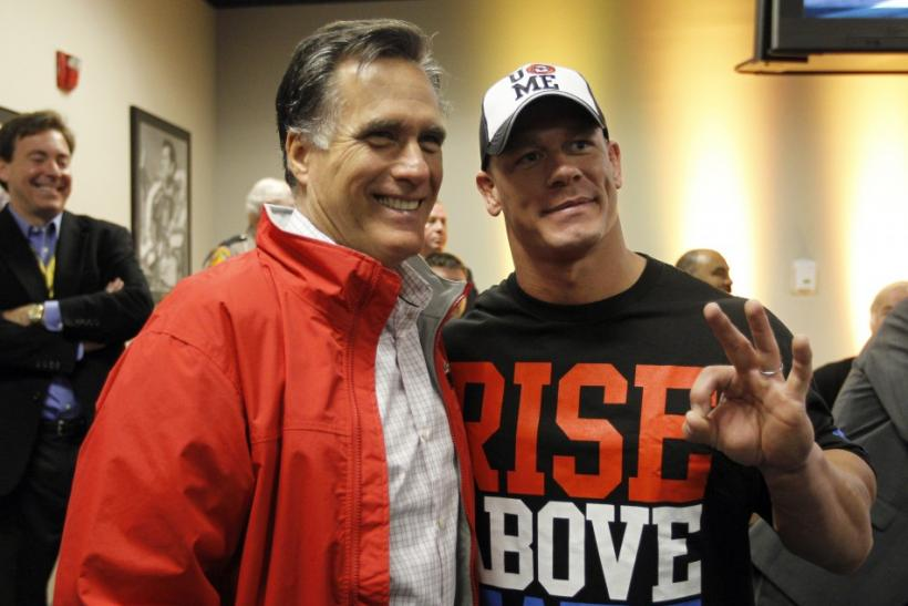 Republican presidential candidate Romney has his picture taken with wrestler John Cena during the NASCAR Sprint Cup Series 54th Daytona 500 race at the Daytona International Speedway in Daytona Beach