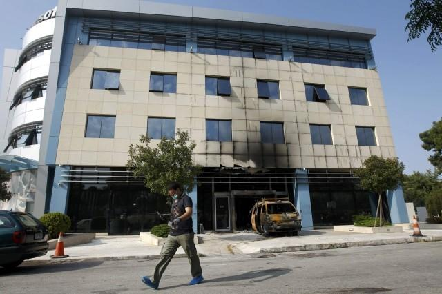 A police investigator searches for evidence following attack on Microsoft's offices at Marousi suburb north of Athens.
