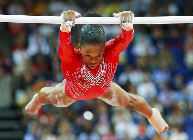 Gabrielle Douglas of the U.S. performs on the asymmetric bars