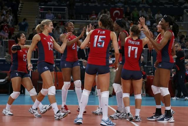 Players of the U.S. celebrate defeating Turkey during their women's Group B volleyball match
