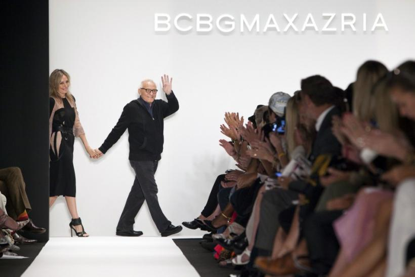 Designer Max Azria waves to the crowd after the presentation of the BCBGMAXAZRIA Spring/Summer 2013 collection during New York Fashion Week, September 6, 2012.