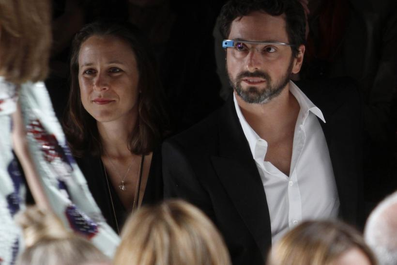 """Google founder Sergey Brin (R) and a guest watch the the Diane von Furstenberg Spring/Summer 2013 collection show during New York Fashion Week September 9, 2012. The show was used as a launching event for Google's new product """"Glass by Google""""."""