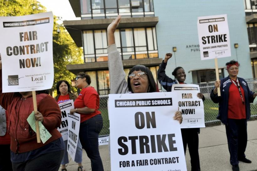 Chicago teachers walk the picket line outside Anthony Overton School in Chicago