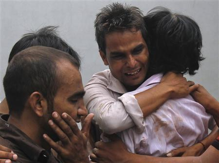 Relatives weep for victims of fire.