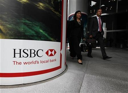 People walk past the entrance to HSBC headquarters in Hong Kong