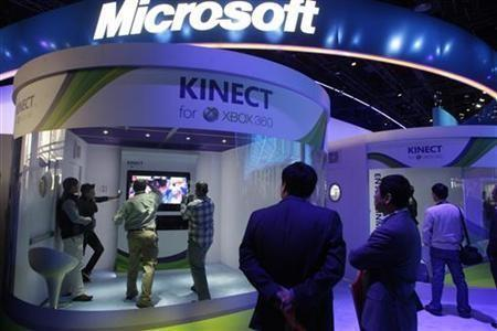 People play a Kinect boxing game on an XBox 360 gaming console at the Microsoft booth during the first day of the 2011 International Consumer Electronics Show (CES) in Las Vegas, Nevada January 6, 2011.