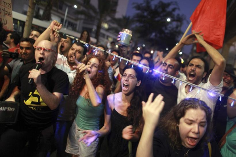 Israelis shout slogans during a march in Tel Aviv against rising property prices in Israel