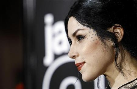 Tattoo artist Kat Von D poses at the premiere of ''Jackass 3D'' at Grauman's Chinese theatre in Hollywood, California