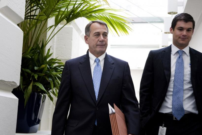 House Speaker John Boehner departs the Republican caucus meeting on Capitol Hill in Washington