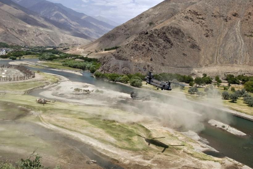 U.S. Chinook helicopters leave after a security handover ceremony in Panjshir province