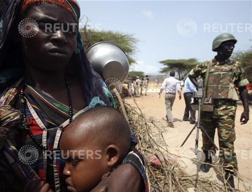 Internally displaced Somali women wait for food aid at a camp in the capital Mogadishu