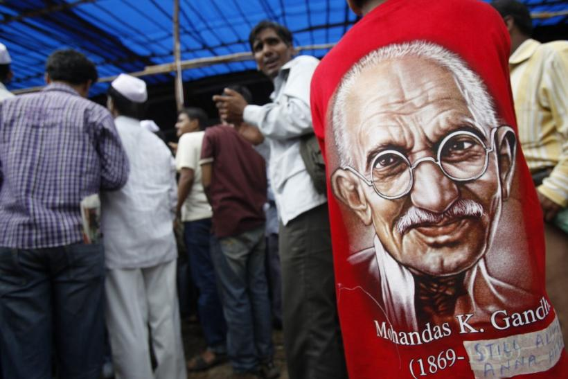 A supporter of veteran Indian social activist Anna Hazare wearing t-shirt with portrait of Mahatma Gandhi participates in a protest rally against corruption in Mumbai