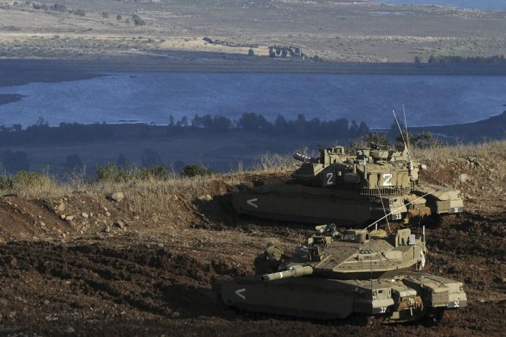 Israeli tanks at border with Syria