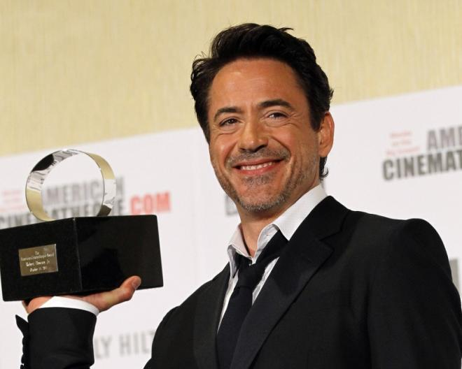174426-actor-robert-downey-jr-poses-with-the-25th-american-cinematheque-award