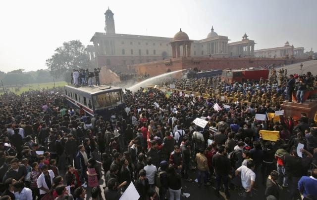 Demonstrators hit by water cannon