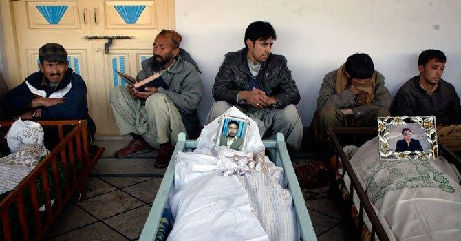 people at Nichari Imambargah Mosque, gathered around coffins of victims who were killed by twin explosions in Quetta the previous day