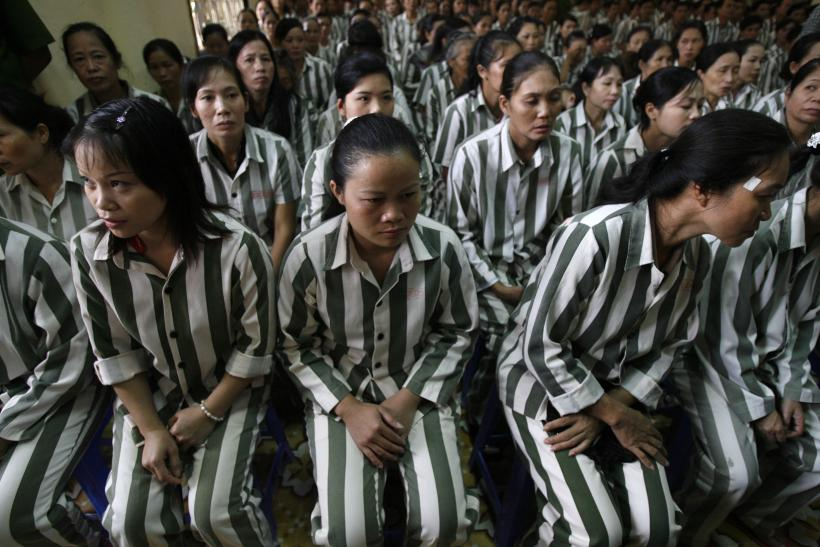 Inmates wait before they are released from Thanh Xuan prison outside Hanoi