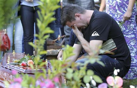 Mourning father outside Brazil fire