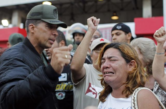Supporters mourning the death of Chavez