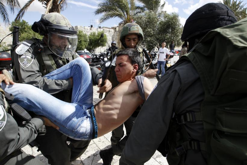 Palestinian man and Israeli soldiers