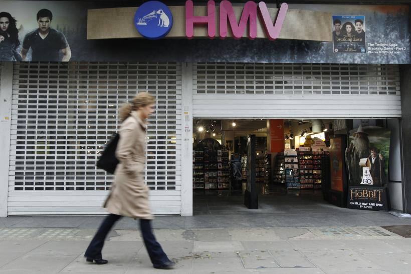 A woman passes a branch of struggling music retailer HMV as it opens on Oxford Street in London