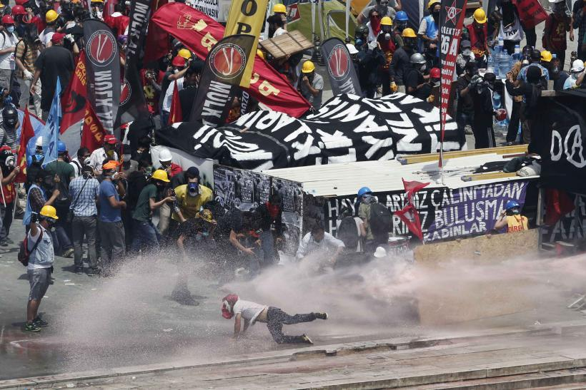 Protester Hit By Water Cannon