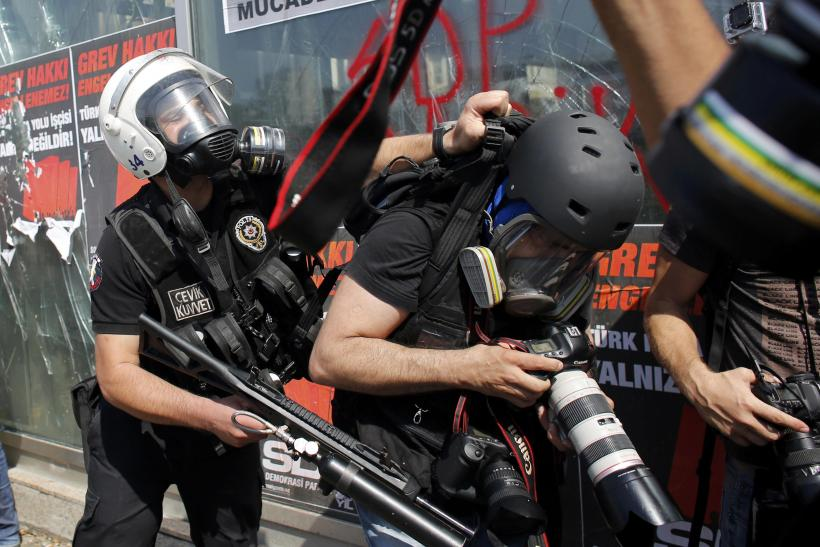 Riot Police Push Photographer